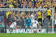 Watford midfielder Abdoulaye Doucoure (16) heads the ball during the The FA Cup semi-final match between Watford and Wolverhampton Wanderers at Wembley Stadium, London, England on 7 April 2019.