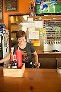 Julia Tier serves Fire on the Mountain beers and other local favorites.