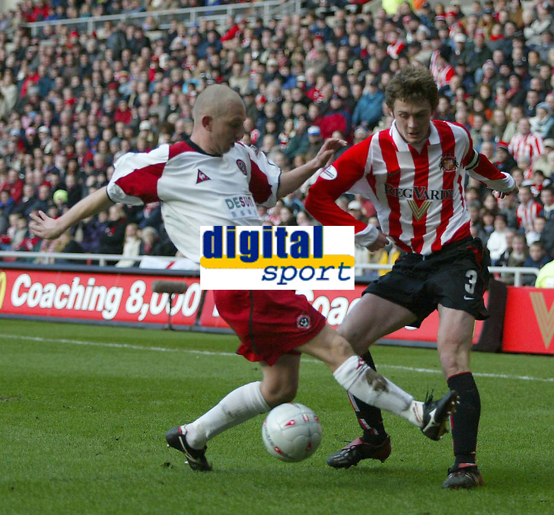 Photo. Andrew Unwin.<br /> Sunderland v Sheffield United, FA Cup Sixth Round, Stadium of Light, Sunderland 07/03/2004.<br /> Sheffield United's Andy Parkinson (l) comes in to tackle Sunderland's George McCartney (r).