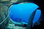 diver explores wreck of <br /> Russian missle frigate, Destroyer 356, <br /> renamed MV Capt. Keith Tibbits,<br /> Cayman Brac ( Caribbean Sea )   MR 282