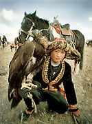 A hereditary tradition. Samarkand, 13 years old, the youngest eagle hunter competitor - his father and grandfather are eagle hunters.<br /> <br /> Eagle Hunting festival in Western Mongolia, in the province of Bayan Olgii. Mongolian and Kazak eagle hunters come to compete for 2 days at this yearly gathering. Mongolia.