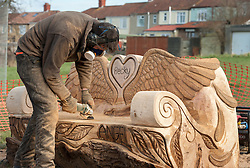 © Licensed to London News Pictures. 16/02/2016. Bristol, UK.  Sculptor Andy O'Neill sands down a memorial bench to murdered Bristol schoolgirl Becky Watts to be unveiled in Plummers Hill Open Space, just metres from Becky's home in the St George area of Bristol. The sixteen year-old was murdered by her stepbrother Nathan Matthews almost a year ago in 2015. Andy has carved the bench from an oak tree trunk. Photo credit : Simon Chapman/LNP