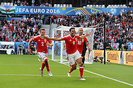 Hal Robson-Kanu of Wales © celebrates after he scores his teams 2nd goal.  Euro 2016, Wales v Slovakia at Matmut Atlantique , Nouveau Stade de Bordeaux  in Bordeaux, France on Saturday 11th June 2016, pic by  Andrew Orchard, Andrew Orchard sports photography.