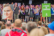 Jo Cox Memorial - Hundreds of people attend, take part in a minutes silence and are led in a verse of We shall overcome by Billy Bragg (pictured).  The 2016 Glastonbury Festival, Worthy Farm, Glastonbury.