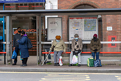 © Licensed to London News Pictures. 20/05/2021. London, UK. People wearing face masks at at bus stop near Hounslow High Street, West London. Hounslow is the first London borough to actively test for the Indian Covid variant B.1.617.2. Photo credit: Ray Tang/LNP