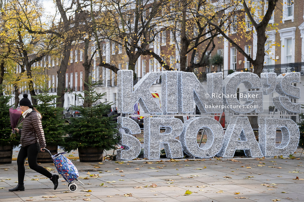During the second Coronavirus lockdow when most non-essential retailers and small businesses remain closed by order of the government, Christmas themed lettering is on the King's Road in Chelsea, on 13th November 2020, in London, England.