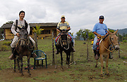 Alamor, Ecuador - Wednesday, Jan 09 2008: Eduardo Tapia (left), Pepe (centre) and his brother (right) on horses at Hacienda Banderones near Alamor, Loja Province, Ecuador.  (Photo by Peter Horrell / http://www.peterhorrell.com)