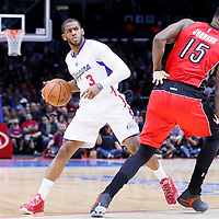 27 December 2014: Los Angeles Clippers guard Chris Paul (3) drives past Toronto Raptors forward Amir Johnson (15) during the Toronto Raptors 110-98 victory over the Los Angeles Clippers, at the Staples Center, Los Angeles, California, USA.