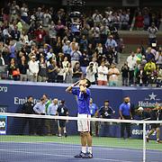 Novak Djokovic, Serbia, celebrates winning the Men's Singles Final against Roger Federer, Switzerland, during the US Open Tennis Tournament, Flushing, New York, USA. 13th September 2015. Photo Tim Clayton