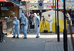 © licensed to London News Pictures. London, UK 26/02/2012. A forensic team investigating the crime scene on Inverness Street after a man was stabbed to death in Camden Town in the early hours of this morning. Photo credit: Tolga Akmen/LNP