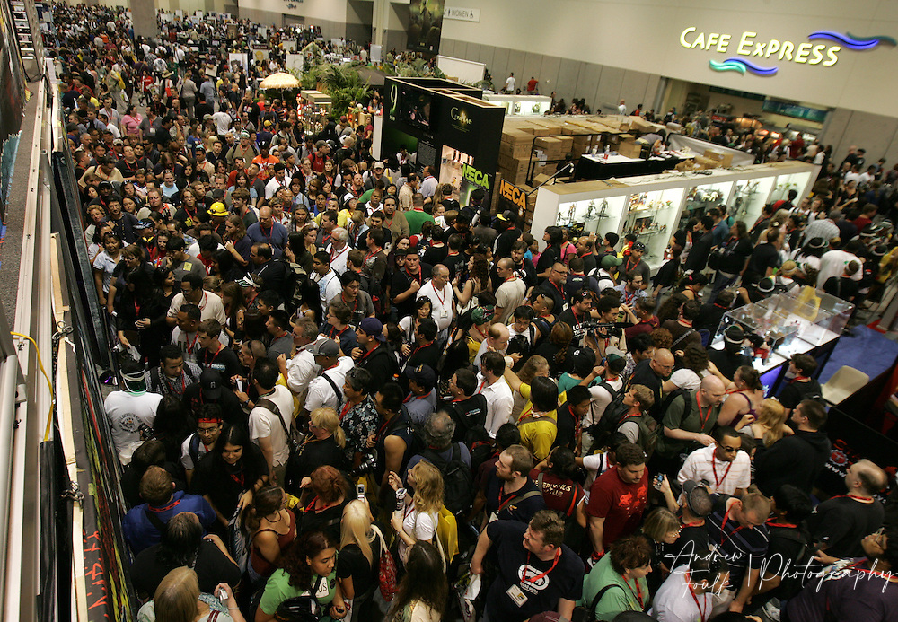 /Andrew Foulk/ For The North County Times/.Fans swarm the Warner Brothers booth to try and get free schwag, during preview night at the 40th annual San Diego Comic Con International.