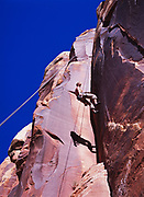Robert Smith rappelling down 3 a.m. Crack on Super Crack Buttress, Indian Creek, San Juan Country, Utah.  Model Released