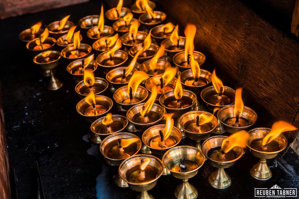 Butter candles burn at Boudhanath in Kathmandu, Nepal.