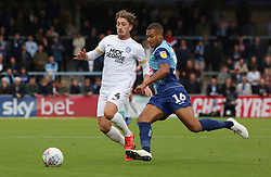 Alex Woodyard of Peterborough United in action with Giles Phillips of Wycombe Wanderers - Mandatory by-line: Joe Dent/JMP - 05/10/2019 - FOOTBALL - Adam's Park - High Wycombe, England - Wycombe Wanderers v Peterborough United - Sky Bet League One