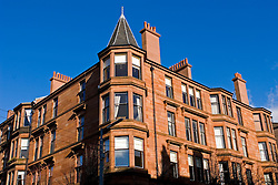 Traditional old red sandstone apartment building in affluent West End of Glasgow scotland