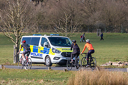 """© Licensed to London News Pictures. 27/02/2021. London, UK. Cyclists enjoy the sunshine in Richmond Park, South West London this afternoon as police patrol the parks with weather forecasters predicting a mild and sunny weekend. This week, Prime Minister Boris Jonson announced his """"Roadmap Map' out of Lockdown with a gradual unlocking of Covid-19 restrictions over the next few months. Photo credit: Alex Lentati/LNP"""