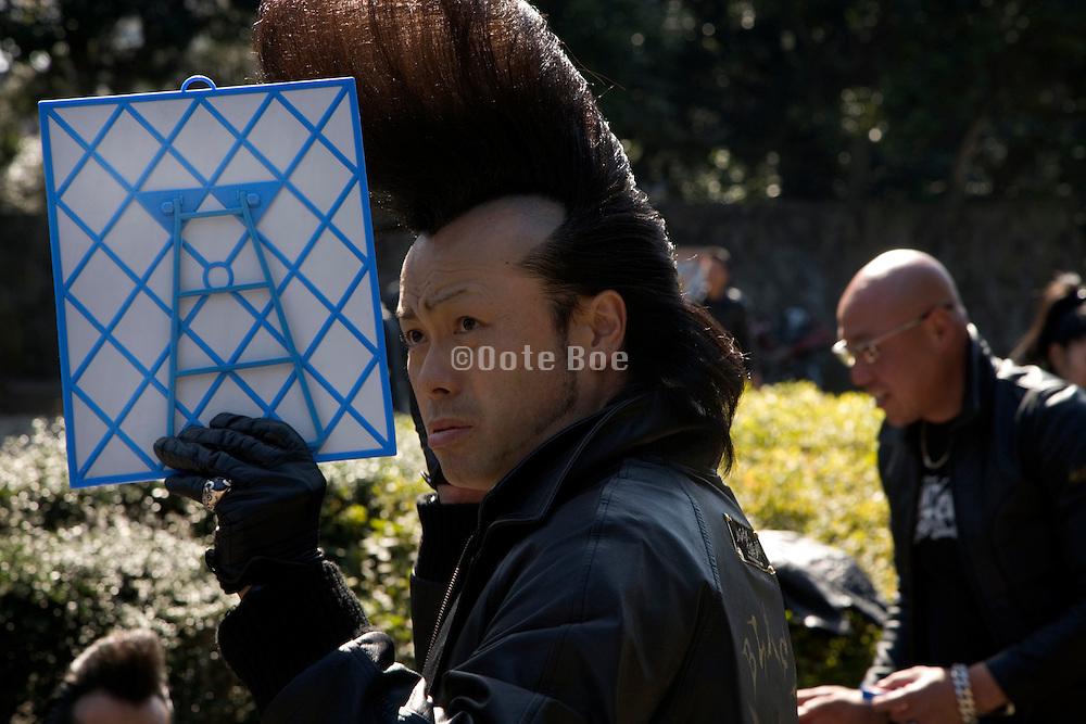Zim from Black Shadow doing his hair in Harajuku, Yoyogi park, Tokyo, Japan 2009
