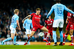 Josh Brownhill of Bristol City is challenged by Oleksandr Zinchenko and Eliaquim Mangala of Manchester City - Rogan/JMP - 09/01/2018 - Etihad Stadium - Manchester, England - Manchester City v Bristol City - Carabao Cup Semi Final First Leg.