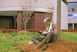 Burroughs Welcome Statue Of Man Reading