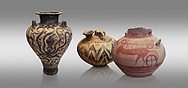 Mycenaean pots and vases depicting octopuses and Mycenaean chariots, National Archaeological Museum Athens. Grey Background<br /> <br /> Left: Three handled Palace Style Mycenaean amphora with octpuses and marinescape decorations motifs, Mycenaean cemetery, Argive Prosymna, tomb 2, 15 cnt BC,  Cat no 6725. <br /> <br /> Middle: Mycenaean three handled styrup jar with painted zig zag  and double axesdesigns, Tholos tomb 2 , Myrsinochori, Messenia, 15th cent BC. Cat No 8376.<br /> <br /> Right:Mycenaean pictorial Krater decorated with a horse and chariot, Tiryns Acropolis - 12-14th cent BC.  Cat No 115. .<br /> <br /> If you prefer to buy from our ALAMY PHOTO LIBRARY  Collection visit : https://www.alamy.com/portfolio/paul-williams-funkystock/mycenaean-art-artefacts.html . Type -   Athens    - into the LOWER SEARCH WITHIN GALLERY box. Refine search by adding background colour, place, museum etc<br /> <br /> Visit our MYCENAEN ART PHOTO COLLECTIONS for more photos to download  as wall art prints https://funkystock.photoshelter.com/gallery-collection/Pictures-Images-of-Ancient-Mycenaean-Art-Artefacts-Archaeology-Sites/C0000xRC5WLQcbhQ