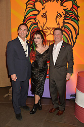 Left to right, ALAN PARKER, HELENA BONHAM-CARTER and JUSTIN FORSYTH Chief Executive of Save The Children at A Night of Reggae in aid of Save The Children held at The Roundhouse, Chalk Farm Road, London NW1 on 12th March 2014.