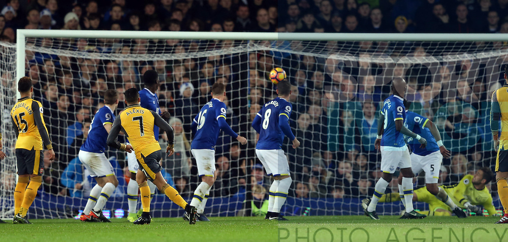 Alexis Sanchez of Arsenal scores the first goal during the English Premier League match at Goodison Park Stadium, Liverpool. Picture date: December 13th, 2016. Pic Simon Bellis/Sportimage