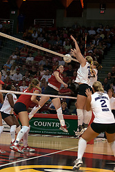 25 September 2004   Panthers reject a slam by Redbirds Laura Doornbos.      Illinois State University Redbirds V University of Northern Iowa Panthers Volleyball.  Redbird Arena, Illinois State University, Normal IL