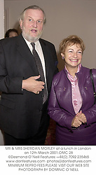 MR & MRS SHERIDAN MORLEY at a lunch in London on 12th March 2001.OMC 28