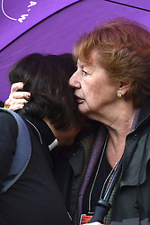 © Licensed to London News Pictures. 21/11/2012. westminster, UK Two women hug at a vigel at Church House in Westminster today 21 November 2012, Candles were not lit and will not be lit until women are ordained as priests. London for day three of the three-day Church of England General Synod. Members last night voted against ordaining women as priests.. Photo credit : Stephen Simpson/LNP