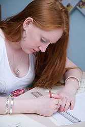 Young woman working in a numeracy and literacy class at the Aspire Training Scheme for young mothers and mothers to be,
