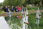 Model boat club members sailing R36r class radio controlled model yachts, Woodbridge, Suffolk, England, UK