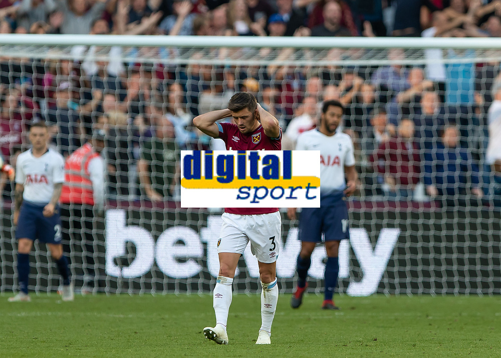 Football - 2018 / 2019 Premier League - West Ham United vs. Tottenham Hotspur<br /> <br /> Aaron Cresswell (West Ham United) reacts after his team are denied a goal at the London Stadium<br /> <br /> COLORSPORT/DANIEL BEARHAM