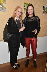 Left to right, THEODORA BARKER and DAISY CECIL at a private view of William Roper-Curzon's latest paintings held at Julian Hartnoll, 37 Duke Street, St.James's, London on 9th October 2014.