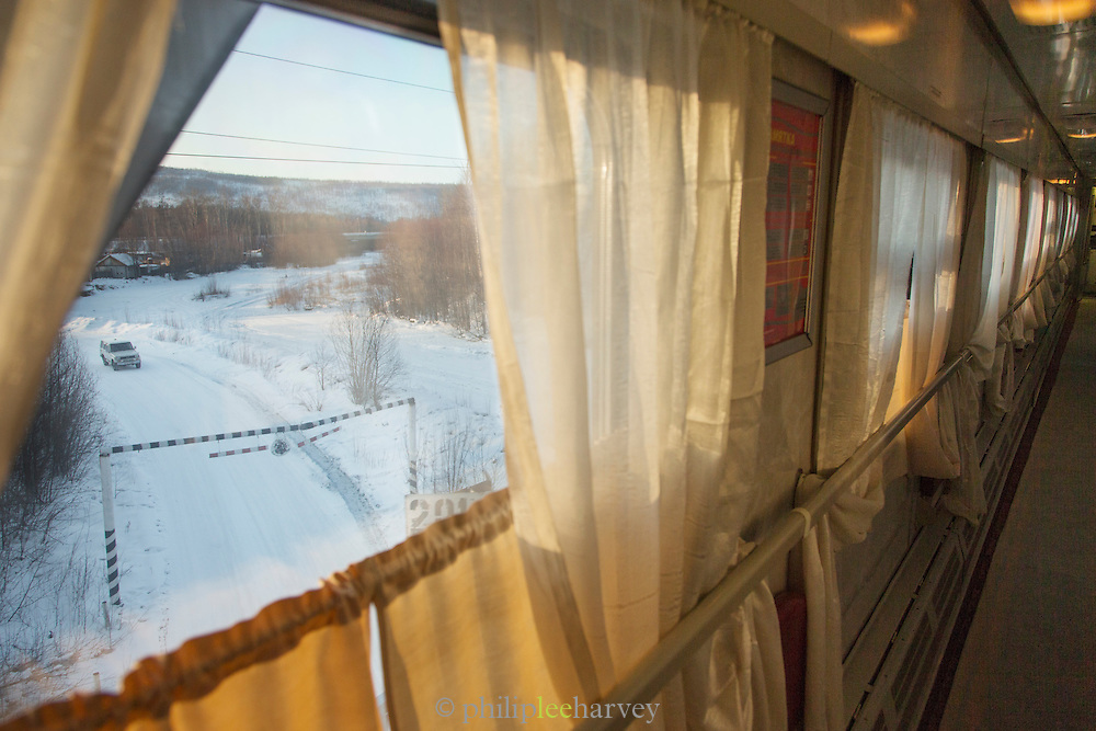 View from compartment Window on-Board the BAM (Baikal-Amur Mainline) Railway Line. Siberia. Russia