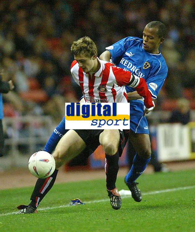 Photo. Andrew Unwin<br /> Sunderland v Cardiff City, Nationwide League Division One, Stadium of Light, Sunderland 14/10/2003.<br /> Sunderland's George McCartney (l) holds off Cardiff's Richard Langley (r).