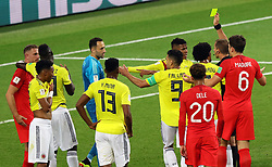 Match referee Mark Geiger shows Colombia's Wilmar Barrios a yellow card for head butting England's Jordan Henderson during the FIFA World Cup 2018, round of 16 match at the Spartak Stadium, Moscow.