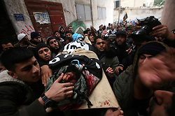 ©Licensed to London News Pictures. 30/12/2011, Gaza. .Palestinians carry the body of militant Momen Abu Daf during his funeral in Gaza City December 30, 2011. Israel killed the leader of an al Qaeda-inspired faction in the Gaza Strip on Friday, accusing him of involvement in firing rockets and a planned attack on the Jewish state from the neighbouring Egyptian Sinai.. Photo Credit: Ali Jadallah /PNC/LNP