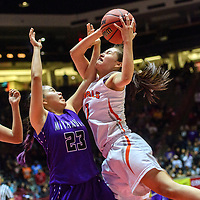 Miyamura Patriot Hannah Murphy (23), left, ties up with Gallup Bengal Ashley Antone (1) in a District 5A quarterfinal at The Pit in Albuquerque Tuesday.