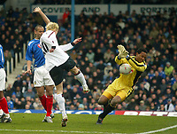 Photo: Scott Heavey.<br /> Portsmouth v Liverpool. FA Cup 5th Round replay. 22/02/2004.<br /> Shaka Hislop saves from Anthony Le Tallec