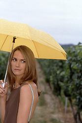 woman holding a yellow umbrella