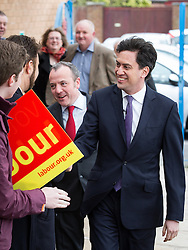 © Licensed to London News Pictures . 14/02/2014 . Manchester , UK . Labour leader Ed Miliband and winning candidate Mike Kane arrive and are greeted by party activists . The Labour Party hold a victory event to celebrate their win in the Wythenshawe and Sale East by-election at Wythenshawe Sports Club this morning (14th February 2014) . Photo credit : Joel Goodman/LNP