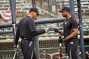 New York Yankees Alex Rodriguez congratulates teammate Eduardo Nunez during batting practice before appearing in the first game since hip surgery with the minor league Charleston RiverDogs at Joseph P. Riley Jr. Stadium July 2, 2013 in Charleston, South Carolina.