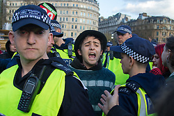 "London, April 16th 2016. A young man shouts as he is detained by police officers in Trafalgar Square, after thousands of people supported by trade unions and other rights organisations demonstrate against the policies of the Tory government, including austerity and perceived favouring of ""the rich"" over ""the poor""."
