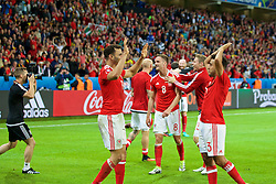 LILLE, FRANCE - Friday, July 1, 2016: Wales' Aaron Ramsey celebrates the 3-1 victory with Neil Taylor after the UEFA Euro 2016 Championship Quarter-Final match against Belgium at the Stade Pierre Mauroy. Andy King. (Pic by Paul Greenwood/Propaganda)