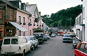 Street busy with traffic in centre of Dulverton village in Exmoor national Park, Somerset, England, 1967