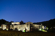 The Benedictine Monastery of Samos illuminated at night, along the Camino de Santiago, Galicia, Spain.