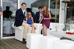 Left to right, EMMA REDMAYNE, JAMES REDMAYNE, EDDIE REDMAYNE and HANNAH BAGSHAWE at the Audi International Polo at Guards Polo Windsor Great Park, Egham, Surrey on 28th July 2013.