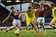 Leon Best of Rotherham United (c) tries to hold off James Tarkowski and Matthew Lowton of Burnley. Skybet football league Championship match, Burnley v Rotherham United at Turf Moor in Burnley, Lancs on Saturday 20th February 2016.<br /> pic by Chris Stading, Andrew Orchard sports photography.