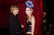 Clare Hesketh and Sophia Hesketh, Tanqueray Philip Treacy couture fashion show and after party,  Pink Paradise Club, Paris. 21 January 2003. © Copyright Photograph by Dafydd Jones 66 Stockwell Park Rd. London SW9 0DA Tel 020 7733 0108 www.dafjones.com