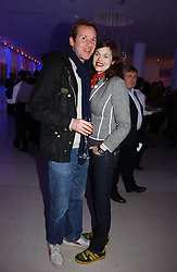 Model JASMINE GUINNESS and her husband GAWAIN RAINEY attending the Tag Heuer party where an exhibition of photographs by Mary McCartney celebrating 15 exception women from 15 countries was unveiled at the Royal College of Arts, Kensington Gore, London on 8th February 2007.<br /><br />NON EXCLUSIVE - WORLD RIGHTS